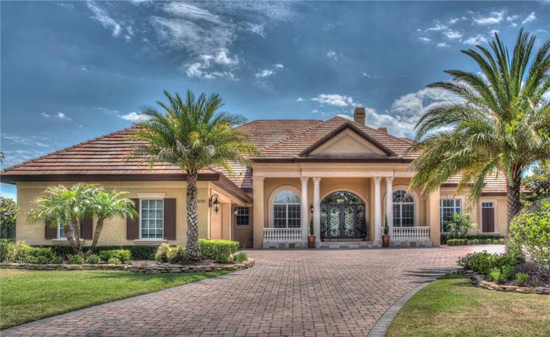 Enjoy ultimate LUXURY LIVING in this sprawling 6,500sf ALL ON ONE FLOOR, CUSTOM DAVE BREWER built spectacular home located in the prominent, 24hr MAN-GATED GOLF COMMUNITY of ALAQUA LAKES! Perfection at is finest, no detail left undone. The 'estate feel' will captivate you upon entering the steel & wrought iron double entry doors. Volume ceilings, warm tones & architectural features highlight dramatic elements including 5 bdrms, 4.5 baths, office/den, GRAND kitchen w/48x84 CENTER ISLAND, WOLF, SUBZERO & BOSCH APPLIANCES, 3 refrigerators & 3 dishwashers, Butler's Pantry, Mud Area, Porte-cochere entry, 5 GAS FIREPLACES, exercise rm w/COFFEE/WET BAR, fabulous BONUS/GAMERM w/WET BAR & dishwasher plus potential theatre rm or 5th bedrm! Master Retreat features massive HIS/HERS closet w/island, dual water closets, jagged edged TRAVERTINE floorg, custom built-ins, Exercise Rm/Nursery & Dressing area. EXPANSIVE, COVERED LANAI is complimented by TRAVERTINE SURROUND, heated SALTWATER POOL/SPA, flagstone coping, sun shelf/'beach' entry. Entertain year-round w/ built-in SUMMER KITCHEN, commercial grill & GAS FIREPLACE while relaxing alfresco in the casual dining area. SEPARATE GAZEBO offers tranquil WATER VIEWS. Toy enthusiasts will love 4-car OVERSIZED garage, paver drive & extensive parking area. Privacy abounds with CUL-DE-SAC location & lot placement yet a resort feel with all that it has to offer! This home is a tastefully-designed masterpiece and truly has it all! Property may be under Audio/Visual Surveillance.