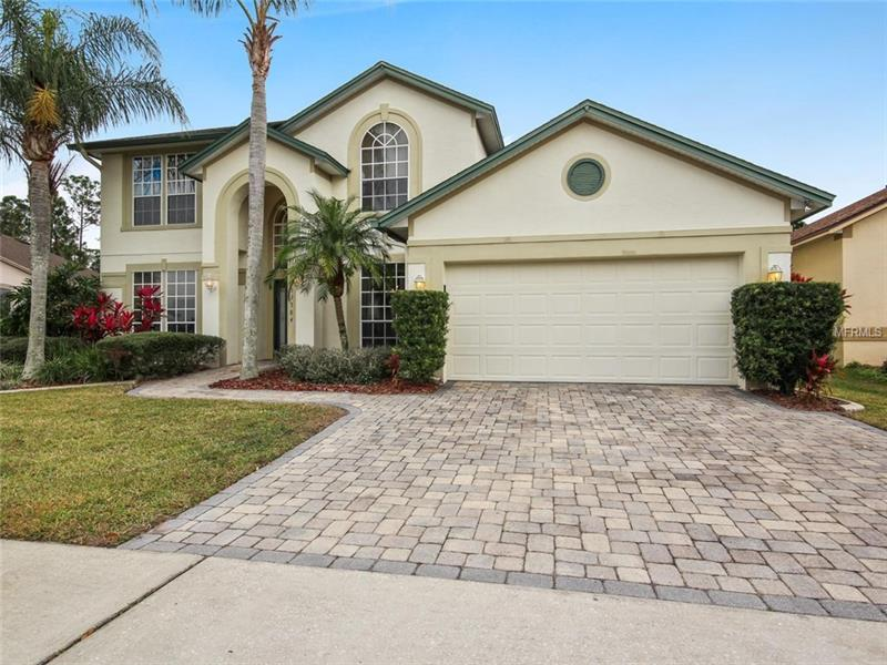Now is your chance to live in the sought after Waterford Lakes community! This 4 bedroom/2.5 bath home has an open floor plan that offers privacy with a **CONSERVATION VIEW AND A PRIVATE FIRST FLOOR MASTER SUITE**. The large master suite has a master bath with two sinks, garden tub, and separate shower. The second bath also features dual sinks. The open kitchen features a center island for meal prep and overlooks large living room with sliders leading to the four season room. There's a loft as an additional bonus area upstairs perfect for an office/art/gaming/workout/flex room or whatever fits your needs. Relax in glorious solitude right in your own spacious backyard. Residents of Waterford Lakes enjoy abundant amenities including a recreation complex with walking trails, pool, racquetball, tennis, volleyball & a playground. Ideal location sets the stage for a truly convenient lifestyle: just minutes from Waterford Lakes Town Center offering more than 100 specialty shops, a variety of restaurants, and entertainment in a park-like, open-air shopping environment. Plus enjoy easy access to 408 and close proximity to UCF & Research Parkway.
