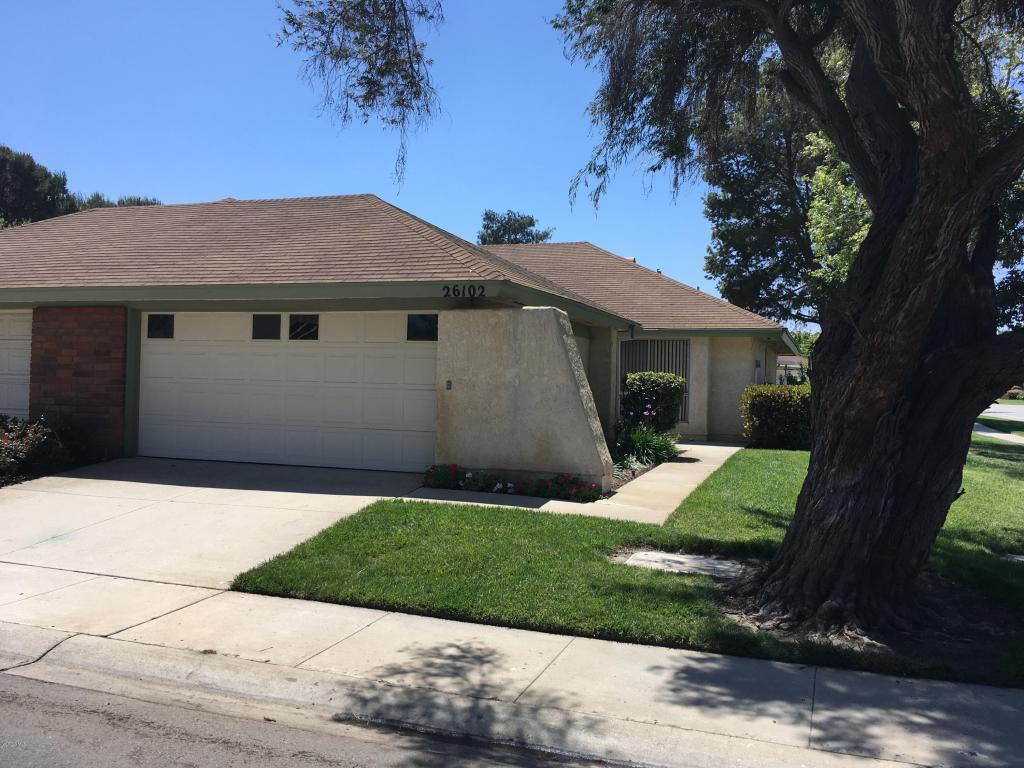 Situated in a very light and bright location, this is a rare two-car garage Coronado floor plan. Two bedrooms and two bathrooms with large living room and dining area. Eat-in kitchen with direct access to garage. Large, open patio with slumpstone wall. Located near Recreation Center.