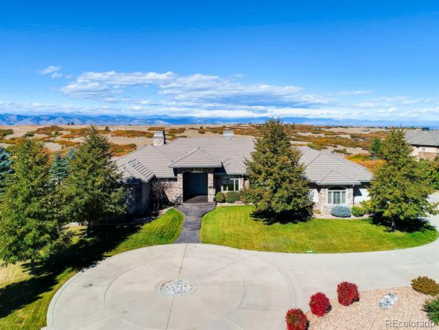 Breathtaking Mountain Views! Premiere location on 2 acres sitting on a high ridge allowing 360 degree views along the front range. Backs to open space and overlooks Daniels Park! This well-designed custom ranch home lives comfortably with its elegant layout. Situated perfectly to provide spectacular vistas in the areas where you spend the most time. Elegant William Ohs kitchen with Wolf and Sub-Zero appliances. Kitchen nook with seamless glass panels to allow stunning unobstructed views. Great room with hideaway sliding doors that open the entire west wall to the patio. The travertine tile deck spans the back of the home with both covered and uncovered sections. The lower level has the feel of a walkout with full sized windows, allowing in natural light. Unfinished space in the lower level allows for adding another bedroom and bath or an additional entertaining area. Advanced lighting system with celestial clock control. Maintenance free exterior. Private gated entrance.