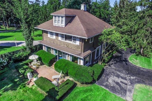 Located on Lake St. Clair with direct access to the lake,this property is the perfect venue for summer fun at its lakeside screen house: swimming, board sailing, boating, kayaking, and bonfires on the beach; and winter fun: cross-country skiing, sledding and skating on the lake.Beneath a grove of enormously tall pines stands its oversized carriage house with its 988 sq.ft.apartment; and the historic arts and crafts country style house,with its lakeside brick terrace, provides an uninterrupted view of Lake St. Clair.Purchased from the original owner in 1975,the current owner gutted the home in 1976 without sacrificing the original and unique arts and crafts appointments, including wood beam ceilings, wood paneling,bay windows, bookcases, a Mutschler Kitchen,designed with premier appliances, including Sub Zero and Jenn-Air; Pella windows, central air, a sprinkler system,wood stockade privacy fences and security system.The current owner has called this oasis home for 43 years.