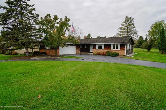 This three bedroom ranch sits on the Grand Ledge Country Club Golf Course.  This home has 2.5 bathrooms, four season room, fireplace and central air.  The kitchen feature a cook top electric range and built in oven and a built in desk area.  The family room has built in bookcases, brick wall with fireplace and lovely wood floors.  The lower level is finished with an additional bedroom and a large rec room. There is also a whole house generator.  The owners are buying you a one year membership to Grand Ledge Country Club as a bonus.  Lovely yard and circular driveway.  The garage has extra storage space so no need for a shed.
