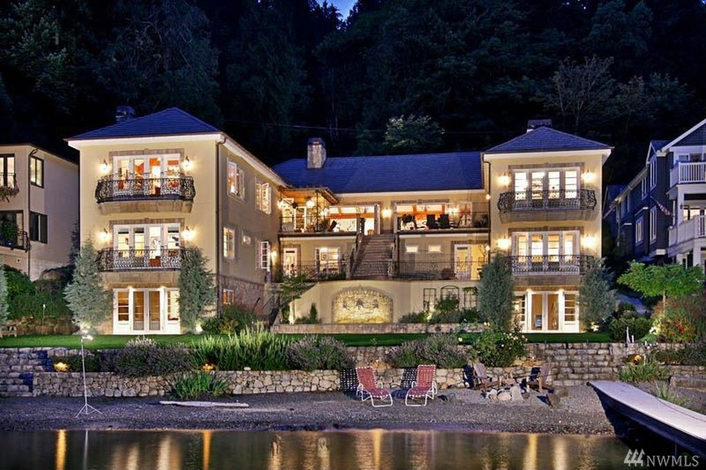 "Divine luxury meets world class design. Epic proportion European masterpiece on 97 ft prime waterfront. Grand entertaining featuring café doors opening entire walls to lakeside terrace. Gorgeous Lake & Cascade Mt views. Theatre, office, billiard room, 2400 bottle wine cellar + tasting room, hobby studio + flex spaces. 2 kitchens, 2 laundry. New dock. Boat lift. Fairytale extraordinaire awaits. Your happily ever after starts here. ""Moving to Lake Sammamish, the BEST move you'll ever make!"""