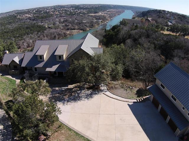 Gated Texas Casual estate ideal for entertaining and family living with privacy, incomparable views & appox 110' Lake Austin waterfront. Sold w/adjacent lot for tot of 7.58 acres.A negative edge pool, casita, outdoor kitchen & wide decks accessed through walls of Nana doors & large wet bar, all create a blend of outdoor and indoor casual luxury. An open floor plan with soaring ceilings, 3 levels, multiple living rooms & additional unfinished quest quarters above the garage with more room to spread out.