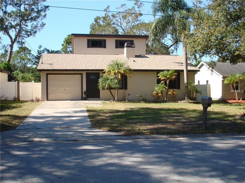 Beautiful 4 bedroom, 2.5 bath home in Desirable Safety Harbor within footsteps of the bay. Home features over 1,800 heated sq ft, updated vinyl siding, newer roof(2014), updated appliances(2014), newer central ac(2014), updated bathrooms, fireplace, fenced yard, storage shed, covered screened patio and sun deck. A Must See!