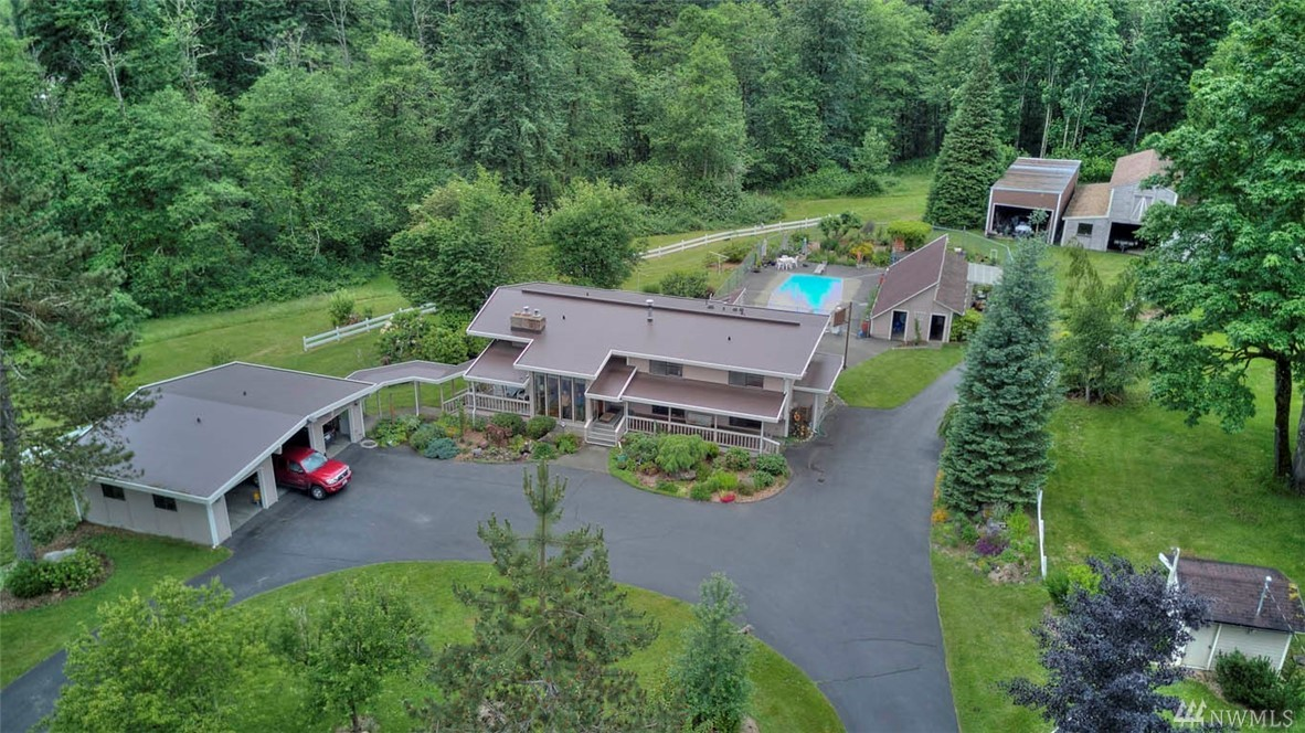 """Hobart Shy 5 acres w/5bdrm home! Spacious, light-filled home w/2nd kitchen downstairs. 32"""" in ground pool, pool house, sport court, spa room, potting shed. Fenced garden w/waterfall & koi pond. Spectacular property w/circular drive, breezeway to 3 car detached garage w/covered RV parking, huge barn & hobby shed. Room to add a second home. This is truly a rare find! Rural heaven, yet so close to HWY 18, Maple Valley, Issaquah & Renton. Top Rated Tahoma schools. Addit'l 9 acres MLS#1197807."""