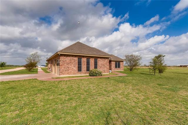 Beautiful gated 3 bd 2 bath home on 5 acres with raised ceilings, converted garage bonus space, formal dining, and tile/laminate throughout. AC unit with humidifier and blacklight for allergies. 2 bd 1.5 bath ADA compliant guest house with an open living/dining and full kitchen. 60X40 metal workshop with half bath and 1200 sf loft space. Cameras and monitoring system throughout all structures. Come home to the country and still be minutes away from Hutto schools, toll roads and small town charm.