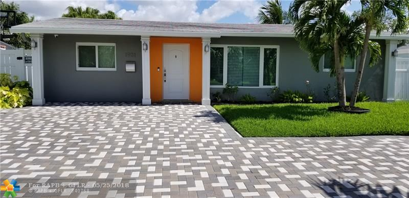Amazing Modern Home! Resort-style living! Property was completely renovated less than two years ago. Huge Pool and Ocean Access with Permitted Dock! Beautiful wooden kitchen cabinet with all stainless steel appliances. Marble, Italian tiles and Water Resistant Floors! Frameless shower door and high-end tub! Modern water-saving toilets and tankless water heater! Crown molding and recessed lighting throughout and Premium marble outdoor pool deck. Hurricane shutters & front impact windows. Reduced Priced!