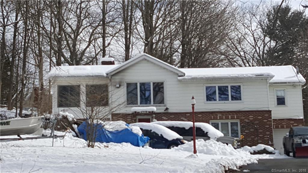 Homes needs TLC, ranch home with finished basement, offers lake views, walking distance to the lake.