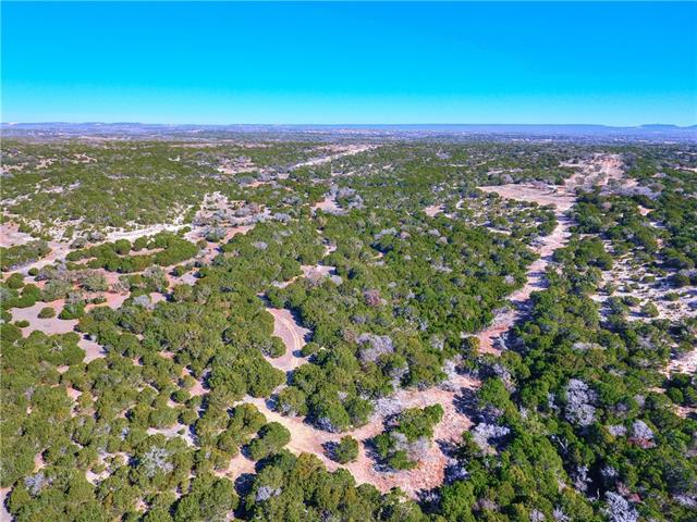Enjoy Texas sunsets and watch the whitetail deer, fox, rabbits, dove, turkey, and many other species of birds while relaxing or hunting on this hill country retreat with spectacular sweeping views. Fully fenced and heavily treed. Perfect for a gentlemen's ranch, company retreat, or hunting lease. This plat must be contracted and closed simultaneously with adjacent 16.53 ac. plat (MLS #1419259).