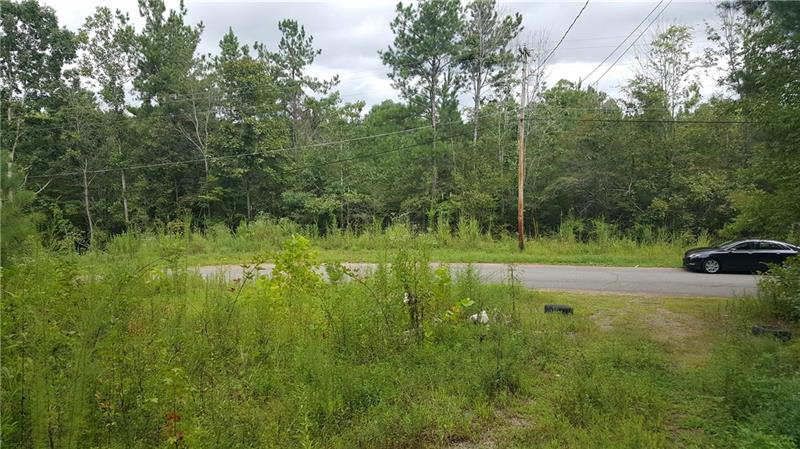 Great investment or homestead lot. 1/2 acre that can have a mobile home or build a single family home. Only 5.8 miles from Lake Point complex. Ask about building a duplex to turn your home into a investment! This lot has power on it and a septic tank w/ new permit.  Already mostly cleared off land.  Ask about a second 1/2 acre lot next door for the same price OR ask about a discount to buy both lots for ~1 acre of land. Hurry!