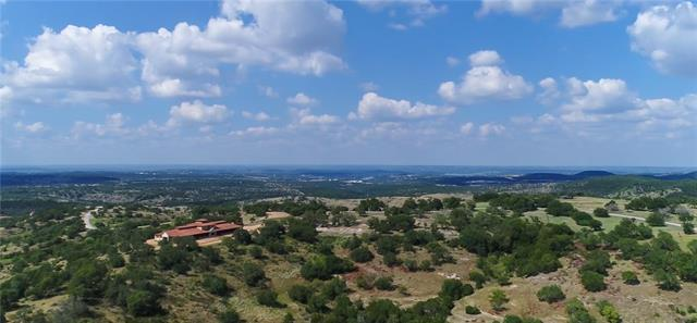 Quintessential Texas Hill County ranch land with Bee Creek running north-south through the western half of the property.  Terrain rises and dips to create breathtaking vistas and lush canyons.  Ranch features, multi-purpose stable facility w/adjacent pens and pastures, Main ranch house w/pool, 6 bay carport w/storage rm, guest home w/office level & observatory level, second residence w/two bedrooms and two full baths, storage building and several pasture horse stalls.