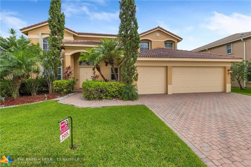 Located in prestigious Weston Hills Country Club. This beautiful 5/4w/a loft, open family rm, & pool residence is approx. 5000 total sq. ft. Grand entry w/double doors, soaring ceilings, tile floors, formal living & dining, & family rms, gourmet kitchen w/wood cabinetry, granite counters, center island, stainless steel appliances, counter bar &  breakfast room, covered patio, heated pool, & priv. fenced yard. 1 bedroom (currently used as a den) on the 1st flr, & 4 bdrms on the 2nd flr. Weston Hills is a gated, golf course community located in the heart of Weston, is a manned-guard gated community nestled amongst two golf courses, mature trees, sparkling, playgrounds, basketball & tennis courts, & swimming pools. Close to parks, playgrounds, upscale shops, restaurants & medical facilities.