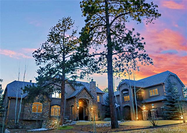 Rarely does a property of such significance as Shadow Mountain Ranch Estate become available. The private and gated estate graces 35 treed acres complete with Pikes Peak views. Dignified finishes abound in the sprawling open floor plan with main level living. 9700sf, 5 guest suites, 8 bathrooms, 11 custom fireplaces, 2000sf apartment with separate entrance - perfect for an au-pair, home office, or guest quarters. No detail was overlooked in this exquisite luxury estate with amenities only rivaled among 5-Star resorts.  he grand foyer leads into the striking two-story great room complete with wood plank ceilings, custom stone fireplace, and sweeping views of Pikes Peak. The chef kitchen delivers custom cabinetry, gourmet appliances with 6 burner gas rangetop, three ovens, and a walk-in butler pantry.