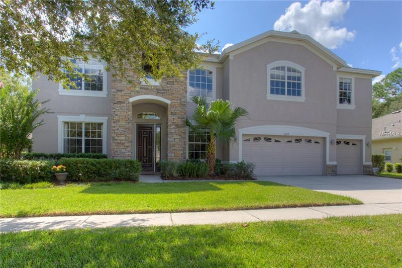 Do not miss the 3D walkthrough tour!  Beautifully upgraded executive pool/spa home with a private estate feel in the exclusive gated community of Chelsea in Tampa Palms.  A stunning conservation cul-de-sac home with 4,081 SF, 4 bedrooms, 3 ½ bathrooms, a large office which could be a fifth bedroom, a huge bonus room (18x25) pre-plumbed for wet bar, and an oversized three car garage.  Enormous gourmet kitchen overlooking large family room boasts granite counters, custom wood cabinets, oversized island, professional style gas cook-top, double ovens, and a large granite butler's pantry.  The oversized downstairs master has a separate sitting area that offers ample space, dual walk-in custom closets, dual vanities, shower and tub. Oversized lanai opens up to a pavered sitting area that offers ample room for entertaining, pool, heated spa, and endless conservation views. Some of the many features include, but are not limited to, salt water pool with new pump, fenced in back yard large enough for playground and swing set, soaring ceilings, wrought iron accented railings and staircase, custom cabinetry, surround sound, large format floor tiles, extensive crown molding detail, new inside paint, large laundry room, upgraded landscape with lighting, sprinklers, and a security system. This home has all the things that you are looking for!  Convenient to shopping, restaurants, USF, Moffitt, VA and recreation. Once you step foot into this residence you will not want to leave, because you know you are home.