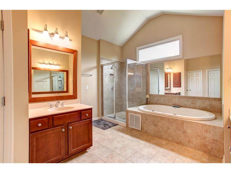 Bright and spa-like with dual vanities, massive shower/jet tub with soaring ceilings