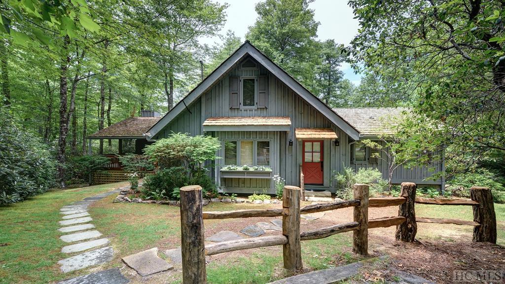 This beautiful 3-bedroom, 3-bath home is nestled among towering hardwoods on a private and level .72-acre lot in the Sheep Laurel neighborhood. The spacious and light-filled retreat was completely renovated in 2015, and its lovely furnishings are included, with just a few exceptions.  The large and inviting living and dining area features vaulted ceilings, massive stone fireplace, gleaming hardwood flooring, and a wall of windows that frames the scenic beauty of the forest outside. A second stone fireplace is featured on the large covered and screened porch, and there is also a large open deck with plenty of sunlight.  The stunning open chef's kitchen showcases stainless appliances, granite countertops, hardwood floor and ceiling, recessed lighting, wonderful cabinetry and numerous luxury touches.  Two of the home's bedrooms are situated on the main floor, and both offer hardwood floors and vaulted ceilings. The master suite has private deck access and a private bath with a large walk-in shower, beautifully tiled and glassed. The main floor guest bedroom includes private bath with tub and tiled shower.  This exceptional mountain home offers both privacy and a convenient location just moments away from all of the Resort's renowned social amenities and recreational pleasures. In wonderful condition and offered beautifully-furnished, this home is ready to be enjoyed today.