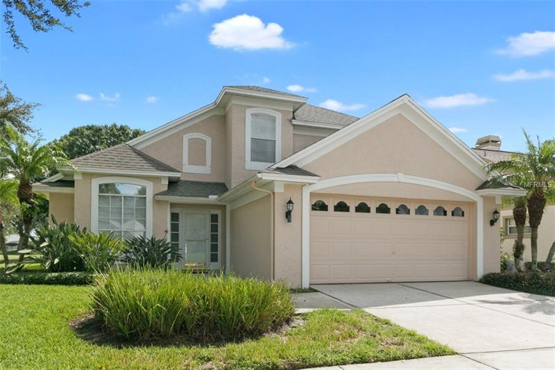 One or more photo(s) has been virtually staged.NEW PRICE 12/14/18! $299,900! Open the front door and see the golf course off this 10x24 Florida Room. This 4 bedroom/2.5 bathroom home overlooks #1fairway/green. It is designed for the family that loves to entertain. The living room with propane fire place and dining room open on to this bright and sunny area. All new carpet in bedrooms ,LR, DR. Upgraded, tiled Master bathroom with dual sinks.  A separate 2ton A/C for master BR plus new 5ton A/C. Dining room has a custom built in buffet. Guest BR has custom Murphy bed with wall unit. ** Tankless Propane hot water. Some hurricane shutters. All this in the gated(24/7 manned security)community of Ventura CC. Equity in golf course with purchase.  Clubhouse with restaurant, bar, upgraded gym, walking and bike paths, Olympic size pool and much more. Close to airport, medical, shopping and attractions.  ,  ** All rm measurements are approx.