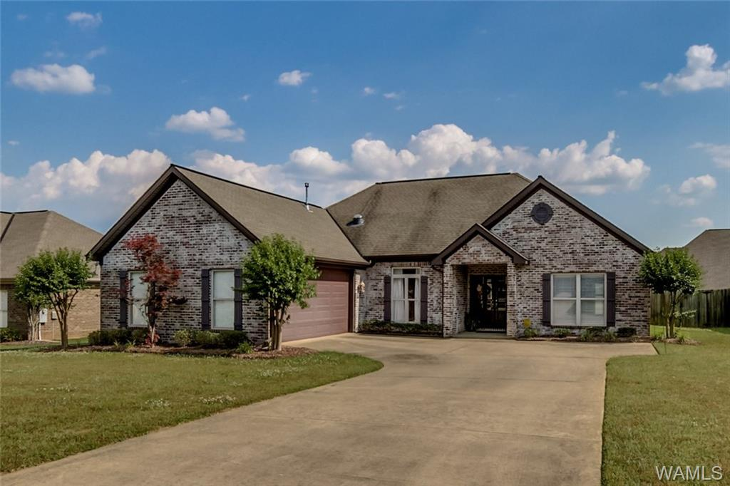 This home is priced to sell and loaded with unique amenities. Pull in the side entry 2 car garage and walk into the laundry/mudroom that is lit from a beautiful skylight. Relax in the great room that opens up to the formal dining, a foyer with a dome ceiling that makes a bold entrance all finished with crown molding and hardwood floors. The kitchen features granite counter tops, under and over cabinet lights with a timer, gas cook top, electric range with 2 ovens, ceramic tile floors and a raised bar for eating. Master suite includes crown molding, cultured marble bathroom counter tops, tile shower, jetted tub and walk-in closet. Private fenced in back yard w/extra patio space to grill, entertain and/or relax.  Full sprinkler system, security system, and NEW HVAC!  Come see it today!