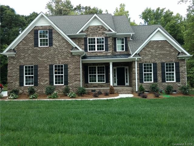 Ballantyne Area, just in SC, MASTER DOWN, 4BR 3.5B, FULL Brick with Stone, Side Loading Garage, Morning Room, Hardwoods on main, Gourmet Kitchen with Granite Tops, Island, Stainless Appliances, Gas 5 burner Cooktop & Double Oven. Master Suite with Tray Ceilings, Walk-in Closet, Tray Ceiling in Formal Dining, Family Room with Gas Logs, Open Floor Plan with Drop Zone, Ceramic Tile in all Baths & Laundry. 2nd Floor Loft & Bonus Room & 3 Bedrooms all have Walk-in Closets, Large Deck on .82 Acres, Public Water & Sewer, No HOA Dues, Under Construction, Come pick your colors now! Broker is Owner