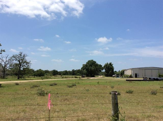 Centrally located between Houston and Austin! Property has large metal multi-purpose building, fencing, county water and electric already on property. Three additional tracts are also available separately (14.47 acres, 11.011 acres, and 10.00 acres), up to a total of 46 +/- acres. See photo for details. This listing is only for the yellow shaded area labeled as TRACT 4.
