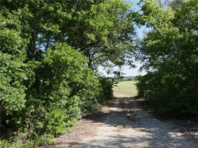 Lucrative Land Investment in Georgetown, Texas - Williamson County 29.731 +/- acre Corner tract with 1060' of road frontage on CR 254 & 1330' on other side with 670' of direct frontage to Williams Drive/FM 2338.  Believe to be outside ETJ, water meter at entrance, two electric poles in place, 5 min. from Highway 183.  Property in Ag status with County Appraisal District = $400 yr in taxes.  No known Deed Restrictions.  Apt required for showing. Gate is locked.