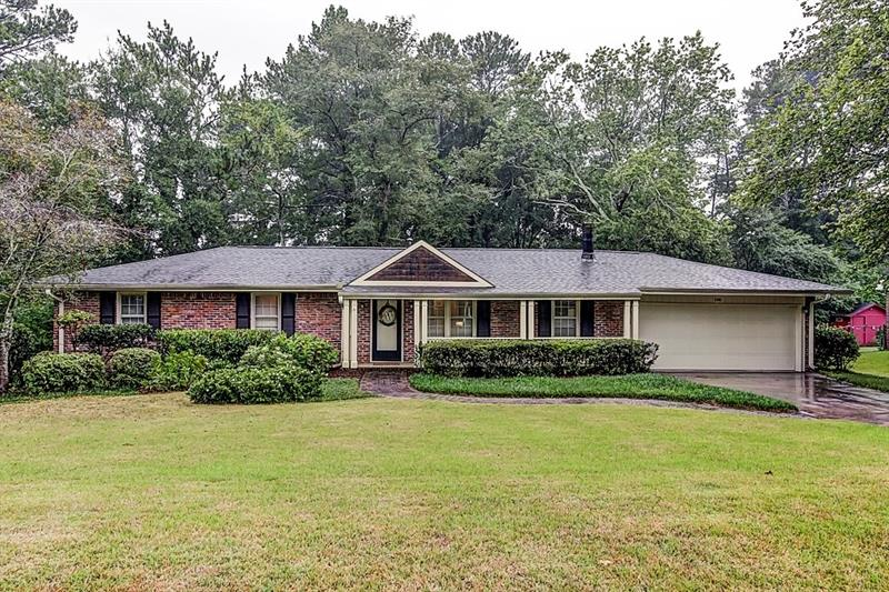 Hurry! Adorable brick ranch in great Smyrna neighborhood! The large living room boasts a cozy wood-burning fireplace and built-in bookcases. Formal dining room perfect for entertaining! The light and bright kitchen has granite countertops and subway tile backsplash. Master bedroom has updated private bath! Additional bedrooms are well-sized and bright! Flex space ideal for home office or playroom. Large screened in porch leads out to the fully fenced backyard. Two car garage! Great location convenient to interstates, shopping, and restaurants!