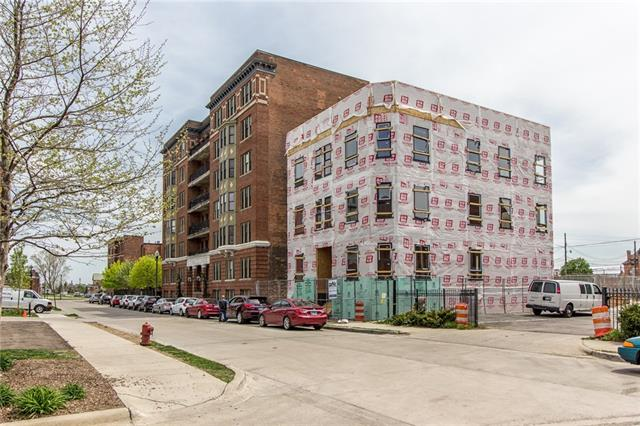 One of Detroit's finest Penthouses! This 2 story home features a private elevator, private 600sf. roof top deck, three balconies, and a private 2 car garage! The open living space spans over 1,000 sf. of the building's top floor. The living room features 12ft windows with a private balcony. The kitchen is a chef's dream, with Bosch and KitchenAide appliances including a double oven, a gorgeous 10ft. waterfall island, perfect for entertaining, and a large pantry. The other half of the top floor offers a 700+ sf. master suite equipped with a private balcony, two walk-in closets, a full laundry room, a large master bath with a soaking tub, stand-up shower, and double vanity. A grand staircase connects the lower level, which offers two additional bedrooms – one with a private balcony –a full bath with double vanity, a secondary washer/dryer, and a den perfect for a home office or fitness room. Wide-plank hardwood flooring and Kohler/Grohe plumbing fixtures throughout. New 15 year NEZ.