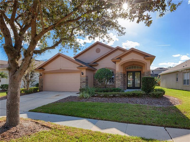 WOW AMAZING CURB APPEAL! This 3 bedroom 2 bath 2 car garage home is BEAUTIFUL with lush mature landscaped lot less than 5 miles from Lake Sylvan. Walk from tiled entry into the formal carpeted living room. Next travel through arched walk way, where you will enter into cozy tiled family room and kitchen/dining room area with vaulted ceilings. The compact  kitchen showcases gorgeous tile back splash, NEW granite counter tops, and stainless steel appliances. Roomy master bedroom with large attached en-suite bathroom. Master bathroom offers a dual sink vanity, walk in shower, deep tub, separate toilet room, and a large walk in closet. Just out back there is a screened in porch with outdoor carpeting on the edge of a sizable grass back yard!  Perfect place to entertain your guests or relax after a long week. You won't want to miss out on this one!!