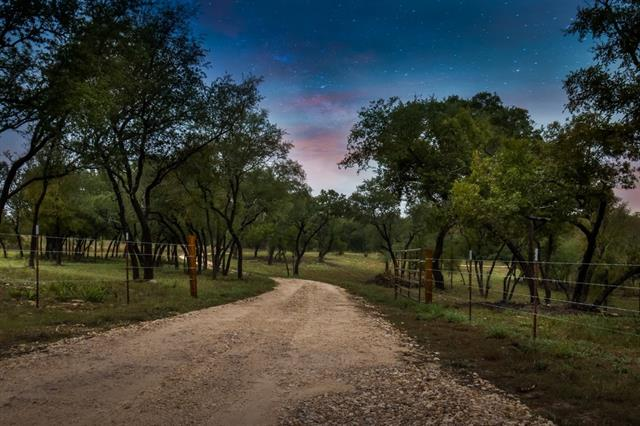 The most beautiful 27 acres in Williamson county hands down. Two creeks, two ponds, Wildlife exempt, completely cleared of cedars, graded, seeded with native Texas grasses and well drilled. 475' deep with GPM rate between 15-25, great pressure! So many choices for future home location, overlook beautiful pond with swimming beach or tuck yourself amongst 100 year oaks with a view!