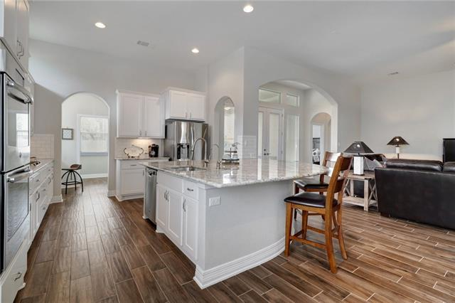 Always feel apart of the action with this open concept floorplan with eat at bar top.