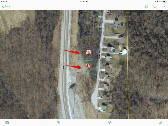 Listing includes lots 15 & 16.  Wooded building site.  City water & city sewer available.