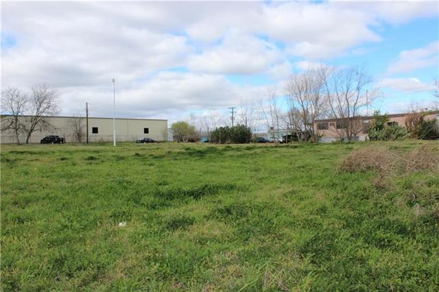 2.5 acres with easy access to hwy 183, hwy 71, Circuit of Americas, ABIA and more.  A three phase electrical outlet on site, concrete docking bay for semi trucks and 1- 18 wheeler dock.  Property has a water well and 2 residential septic tanks onsite.  Fully fenced chain link fence.