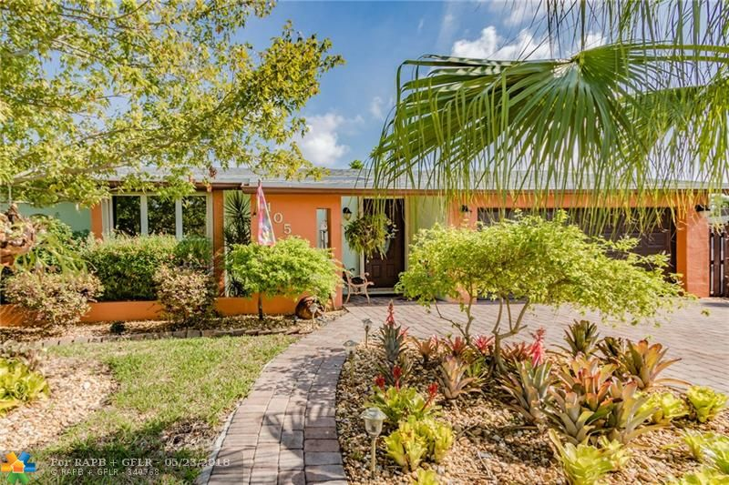 Beautiful 3 bedroom 3 bathroom paradise with a split bedroom plan and 2 master suites on a corner lot. Private fenced yard, resurfaced pool, butterfly garden, new roof, new a/c, new washer/dryer, easy to use hurricane shutters, new garage door, so much to list. The stove, water heater, dryer, and pool heater are all on gas, so electric is only around $175/month. Tinted windows, built out attic for storage. Perfect home for a family who needs 2 master bedrooms. No HOA fee, and minutes from Sawgrass Mills