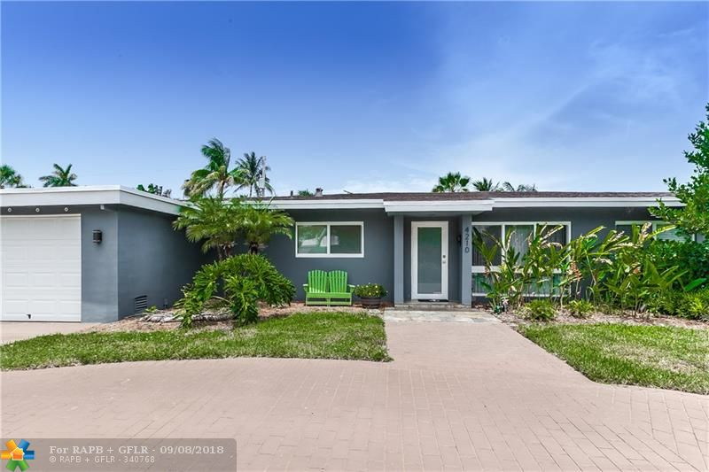 Excellent Coral Heights Home. Wide open space with lots of light. New kitchen and tile floors. High impact windows. Tank-less gas hot water heater.  New washer and gas dryer. Back yard is spacious, build a pool or make a garden. This is a great home, don't miss it!