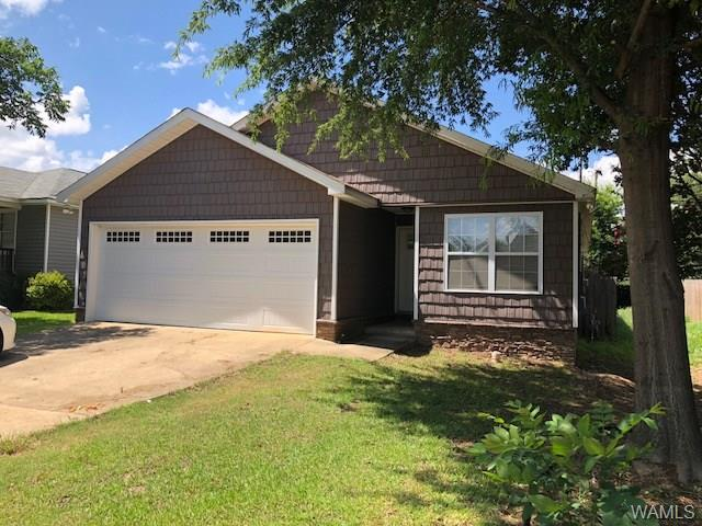 Live in luxury! Very nice, completely renovated 3BR/3BA home with all the upgrades: beautiful hardwood floors throughout (ceramic tile in baths), granite countertops in kitchen and all baths, master with tray ceiling that features (dimmer) recessed lighting and walk-in closet, master bath with jetted tub and cable access. Other bedrooms each have their own full bath for added privacy. Family room features a beautiful stacked stone, gas log fireplace. Outdoors you can enjoy a covered back porch with ceiling fan, large deck, and fenced back yard with 12x24 storage building/workshop and stacked stone on exterior as well adding a nice touch.  Home is conveniently located within walking distance to great shopping and dining options as well as a very short drive to U of A. Seller will also lease home.