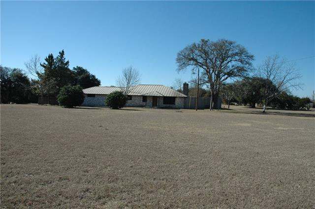 NO HOA! NO DEED RESTRICTIONS! NO CITY TAXES!  Five full unrestricted acres. Great for horses or home based business. Three Bay Workshop/Office 11X34 Approx. 4 Stall Metal Pole Barn 44X24 Approx. Tough Shed 12X14, Shed 8X10, Mini Barn 12X24. Wonderful open floor plan. Oversized large master bedroom with glass doors to covered patio. Large open kitchen with extra storage space that opens to dining area and living area. Oversized utility room. 2 car garage and 2 car carport. Security gate code in lockbox.