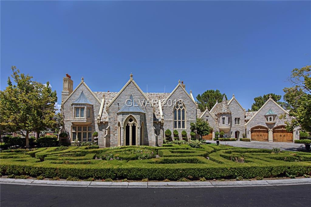 11,662 Total SF ($322/SF) - Waterfront castle in Lakes Estates. Circular driveway w/porte-cochère. Cast stone exterior walls, slate roof, custom stained & beveled windows, & $1.5MM in carved mahogany. Open floor plan kitchen w/domed dining nook, Sub-Zero fridge, & GE Monogram appliances. Master w/balcony, jetted tub, big hers&his closets. Rear yard w/lap pool, outdoor kitchen, ramada, & private dock. Library w/hidden entry to dungeon.