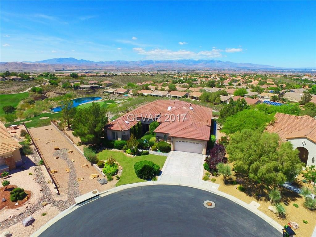ONE OF A KIND GOLD KEY ANTHEM MODEL W/AMAZING GOLF, STRIP, & MOUNTAIN VIEWS! THIS HOME HAS BEEN SPECIALLY-SITUATED TO OFFER PANORAMIC VIEWS OF THE ENTIRE LAS VEGAS SKYLINE ALONG WITH 4 HOLES OF THE LEXINGTON GOLF COURSE. GOLD KEY UPGRADES INCLUDE 3RD BEDROOM W/FULL BATH, EXTRA STORAGE ROOM, AND EXTRA SKYLIGHTS. PERFECT FOR ENTERTAINING W/EXPANSIVE LIVING AREA, SPECTACULAR CURVED WINDOWS, WET BAR, CHEF'S KITCHEN & LARGE HOME OFFICE.