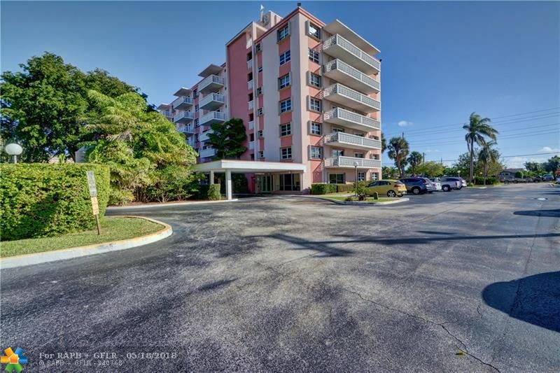 Location.Location.Location. Great 2Br-2Ba value in East Fort Lauderdale. Enjoy fabulous views of pool, garden, as well as the miles long view of tree tops and skyline from your private 6th floor balcony and both bedrooms. Updated kitchen and baths. Large Master w/huge walk-in closet. Utility storage rm. Low maintenance fees. Low electric. 2 miles to the beach. Windows and balcony sliders are ALL High Impact PLUS hurricane shutters. Close to LA Fitness. Fresh Market. Publix and Coral Ridge Mall.