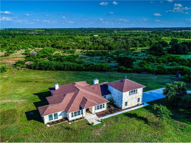 This home is anything but typical and features high quality upgrades everywhere you look. Every detail was carefully planned. 360 Degree Views! This custom home is located just minutes NE of Burnet and about 35 minutes NW of Austin w/ easy access off paved Cty Rd 254 providing the best of opportunities for country living and still offers easy access to the city. Completely fenced w/2 large stallion paddocks, 4 pipe/wire extra large field paddocks.