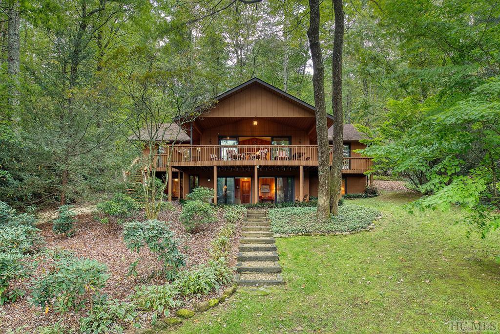 "Well kept and maintained 4 bedroom, 3 bath, 2600+ heated square foot classic cottage on Historic Lake Toxaway.  Nearly flat topography down to shoreline with 109 feet of lake frontage and boathouse. Grandfathered ""T"" boat dock for additional boat tie up.  Property has a wonderful canopy of trees, rhododendrons, and mountain laurel. Circular driveway makes for easy ingress/egress.  Home is being offered for sale furnished with few exceptions.  Ski boat also to convey with sale."