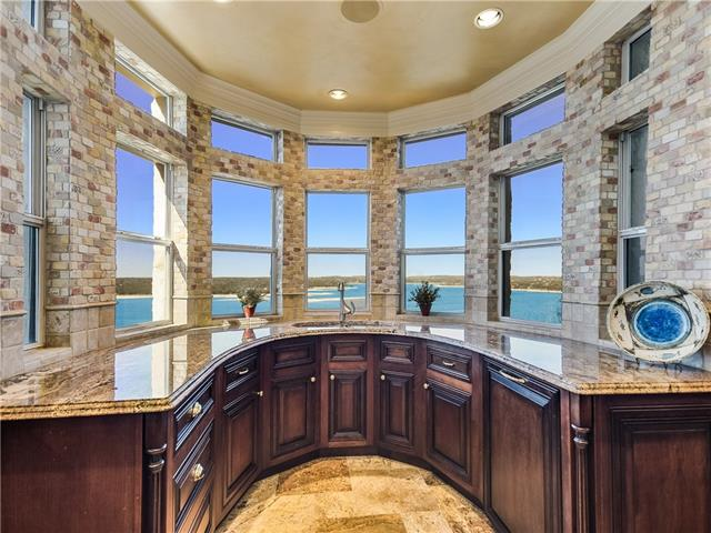 The most stunning unit in Villas on Travis. Over $500,000 of upgrades have been put into this unit and it simply doesn't compare to anything else you'll show in the complex. The best location on the back corner with an unobstructed view of Lake Travis and spectacular sunsets.  Originally priced at over $1,200,000.  The finish out will blow you away with gorgeous marble, intricate wood details and so much more.