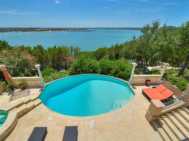 Stately waterfront home in the exclusive Northshore on Lake Travis! Spectacular custom estate w/ views, built by famous architect Jauregui & boasts 11,696 sq ft of heaven on earth. Unique specimen from Italy incl. imported Monastery front doors, stained glass windows, marble columns, & inlaid ivory. 4 unique fireplaces, wine cellar, study/library, fitness room, media room, game/bonus room, sauna, plus all beds have en-suites. Parklike landscaping w/ 12 waterfalls, patio island, 2 bridges, a pool, & a spa.