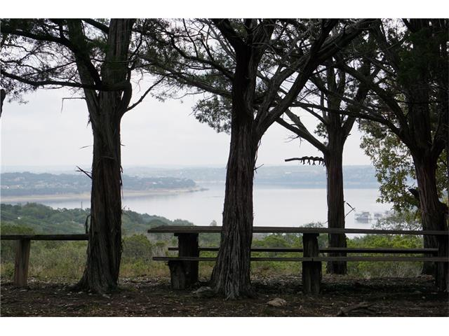BACK ON MARKET AND REDUCED PRICE!  28 ACRES w/ SPECTACULAR LAKE VIEWS! Perfect for a private estate lot, close-in ranch, or development opportunity! Subdivision, wedding venue, vineyard, equestrian, anything!  NO RESTRICTIONS! Low taxes (wildlife exemption). Close to Rough Hollow and new Lake Travis Middle School. Tremendous growth area! LTISD too! Cabin on property is cool but of no value. Well and electricity on site. Seasonal creek and pond, lots of wildlife!