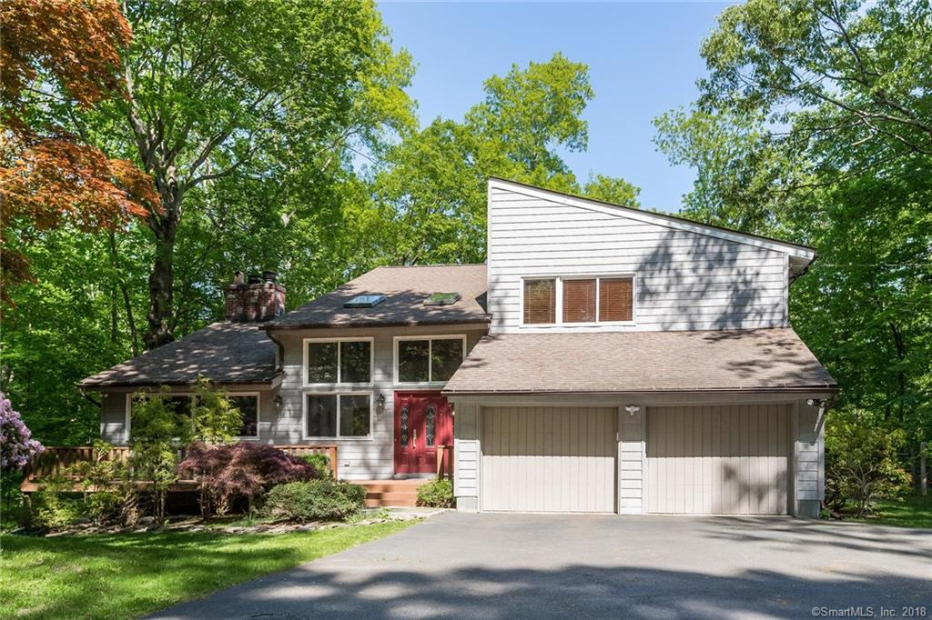 Set way back on a private enclave of homes, just north of the Merritt, sits this Modern splendor in this chic contemporary home.  Washed in sunlight, the large windows let in the light and awards you with views of nature on this quiet 1.6 wooded acre jewel.  With an open design that seamlessly flows from Living Room to Family Room to Kitchen this layout is perfect for entertaining.  The gorgeous, expansive kitchen is equipped with granite counters, Bosch, Subzero, and Thermador appliances, and a center island.  The Eat-in Kitchen and Family Room both have access to a large deck overlooking nature.  There are four nice sized bedrooms with hardwood floors.   The Master Bath has been beautifully renovated and the finished lower level creates even more space for entertaining.  It's perfect for media, extra storage, play area or create a great gym.  If you've been waiting for a great contemporary home to hit the market, then your wait has ended. This home has it all!