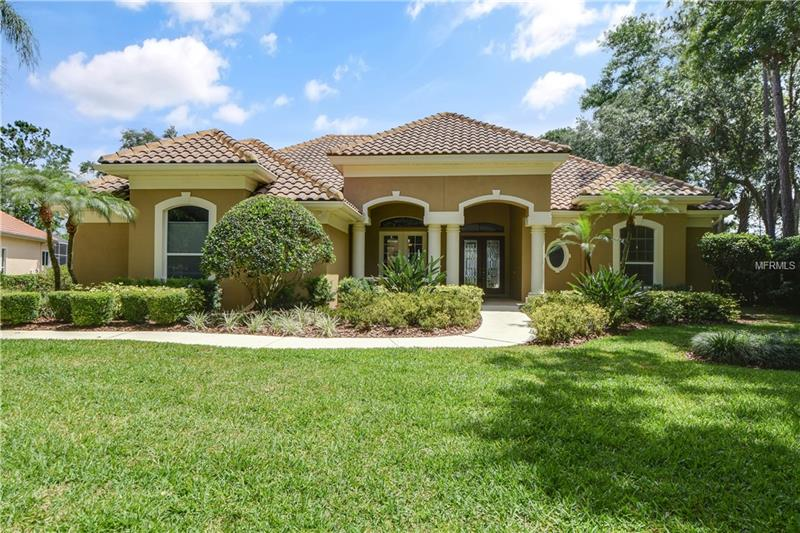 Say hello to paradise! This gorgeous estate features stunning panoramic lake views! Situated in the desirable Lake Forest community with 24/7 security and manned guard gate! The kitchen is spacious and bright with stainless steel appliances, stunning granite counter tops, and solid wood cabinets! Enjoy the high ceilings throughout, updated light fixtures, and hand scraped wood floors! Bonus room has pool and lake views, with plenty of windows, and a  oversized balcony! Enjoy the fully enclosed resort style pool and patio on hot summer days. The beautiful sunsets and sunrises over the lake surrounded by gorgeous trees! Maybe you'll even get to see an eagle! The community amenities include Tennis/Pickle Ball, kayaking through the lake, JR Olympic swimming pool, and large club house with exercise facility!  Both HVAC units are scheduled to be replaced late October.