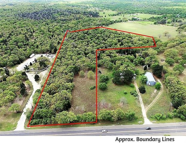12.7 Beautifully wooded acres w/ great view in back. You will need to walk the property, which is mostly wooded w/ a few openings. Was part of 530 Hwy 95 S so you can see how beautiful it would be selectively cleared or left wooded for max. privacy. Back opens to a small amount of pasture & some amazing views of the countryside.Property behind it is family land and will have the same restrictions as this property. Water meter in place. Partial fencing. Ag exempt on pasture only. Drone shows approx borders