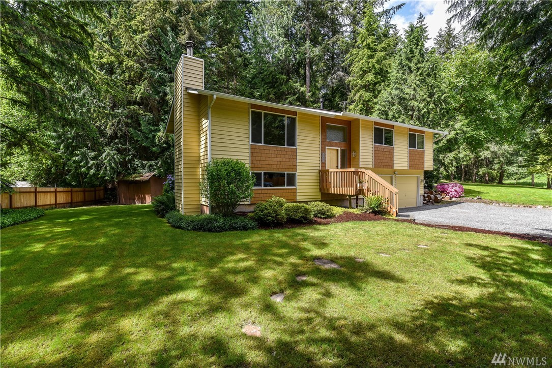 Create your private bliss in this home on a shy acre of tranquil paradise. Around the corner from renowned Lake Wash schools. Huge yard for playing & gardening. New S/S apps & gas stove. Master w/full bath, 2 more bdrms & another full bath on the main level. Lower level w/1 bdrm, ½ bath, HE W/D, & rec room w/wood stove. New carpet; 2017 ext paint & gutters; 2014 windows; 2013 roof; A/C & furnace ~2006. Minutes to Microsoft, Costco & 520. Lots of potential to increase value here. Pre-inspected.