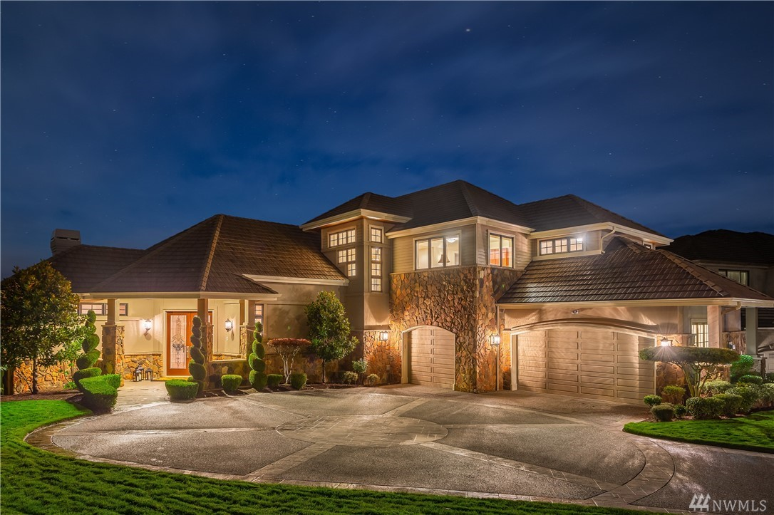 This stunning Lochwood Lozier estate in The Reserve at Newcastle is the epitome of NW living. Perched above the 5th hole of the China Creek golf course, this home captures the best views around. NW-inspired architecture w/rich wood moldings, teak hdwds & custom finishes throughout. Enjoy 2-oversized patios, entertain in the spacious basement w/game room, sports bar & theater. Relax in the spa-like master. Situated in the area's top golf & outdoor communities, explore all Newcastle has to offer!